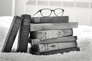 "<img src=""expand-your-reading-list.jpg"" alt=""Bookrack laying on floor with glasses on top"">"